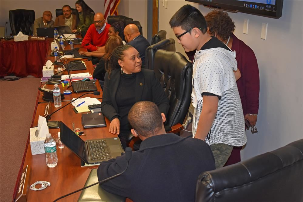Students teaching School Board Members to code using Scratch