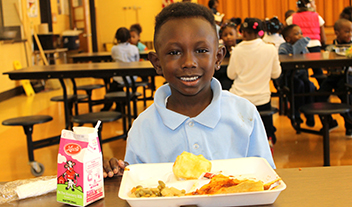 student with school lunch