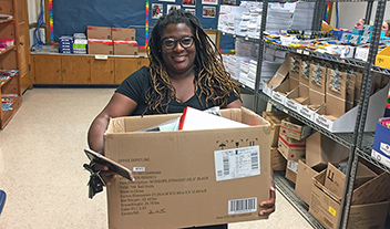 Teacher selecting free items at Petersburg Teacher Supply Closet