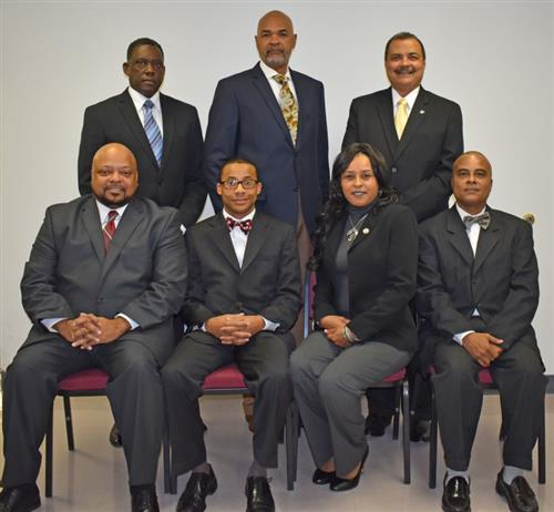 Seven members of the School Board